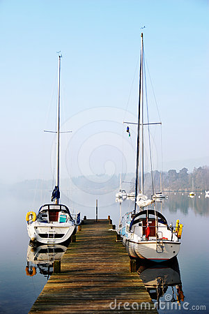 Free Pleasure Yachts Moored On Rustic Jetty Stock Images - 24503744