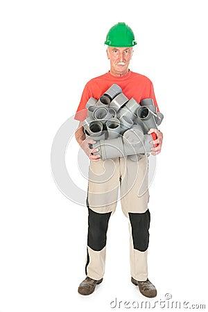 Plombier avec beaucoup de tuyaux