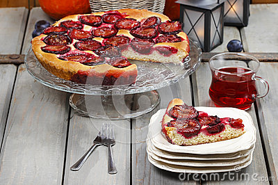 Plum pie in autumn party setting