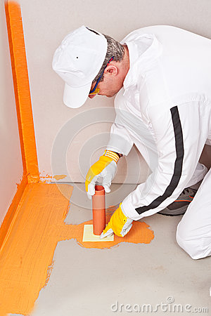 Plumber apply waterproofing cuff