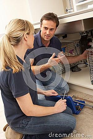 Free Plumber Teaching Apprentice To Fix Kitchen Sink Stock Photo - 18745080