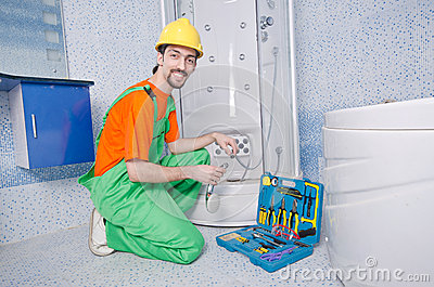 Plumber working in  bathroom
