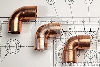 Plumbing fittings against a mechanical blueprint
