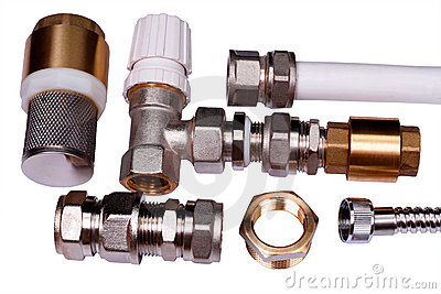 Plumbing parts on a white