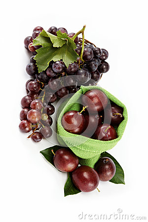 Plums and a bunch of grapes isolated.