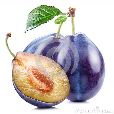 Plums with a slice and leaf