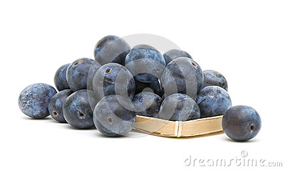 Plums on a white background close-up