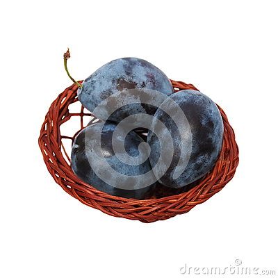 Plums with wicker baskets isolated