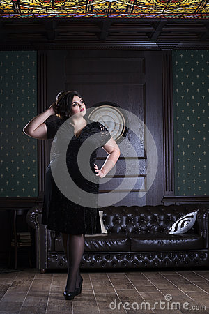 Free Plus Size Fashion Model In Black Evening Dress, Fat Woman On Luxury Interior, Overweight Female Body, Full Length Portrait Royalty Free Stock Photos - 91232548