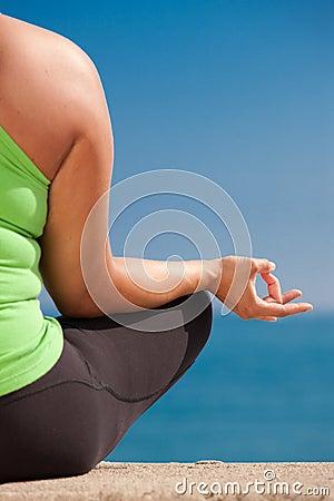 Plus size female practice yoga outdoor