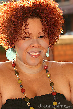 Plus Size Female with Red Hair and Bright Jewelry