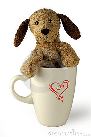 Plush dog in cup