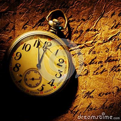Pocket clock on old paper