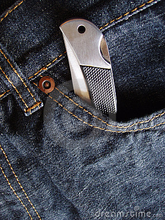 Free Pocket Knife In Jeans Pocket Royalty Free Stock Images - 643899