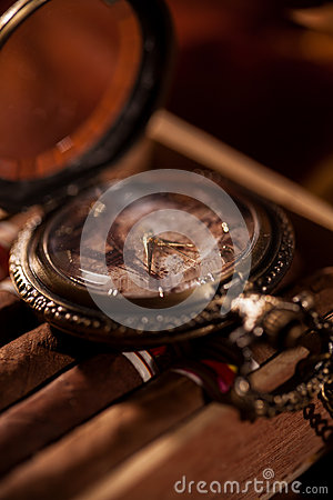 Free Pocket Watch Close-up Lying On Top Of The Package Of Cuban Cigar Stock Photo - 51622810