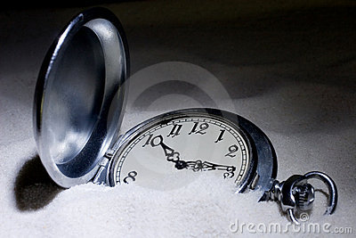Pocket watch covered with sand