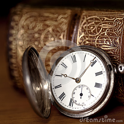 Pocket Watch with Old Book