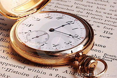 Pocket Watch on Open Book