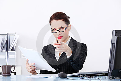 Pointing businesswoman holding files.