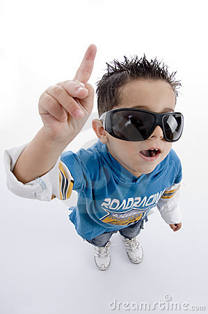 Pointing cute little boy with sunglasses