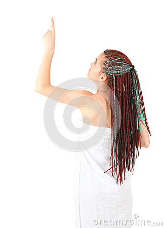 Pointing girl in african hairdo after shower
