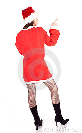 Pointing girl in red Santa clothes and hat