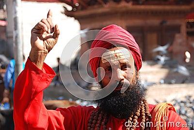 Pointing Hindu man Editorial Photo