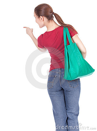 Pointing woman with shopping bag
