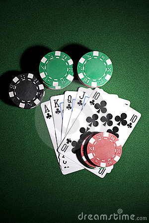 Poker cards on green background