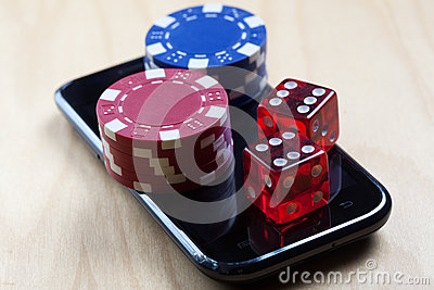 Poker Chips and Dices on top of cell phone