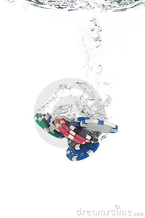 Poker chips falling into the water