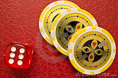 Poker chips and number 6 dice