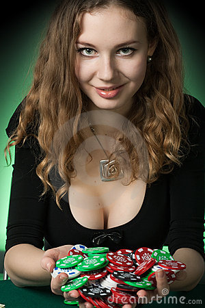 Poker player in casino with cards and chips