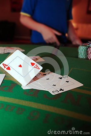 Poker player throwing in loosing cards