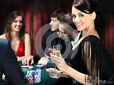 Poker players sitting around a table
