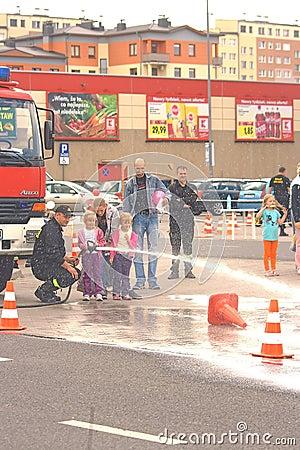 Poland , july 13 2013 - Firemen show children as u Editorial Stock Photo