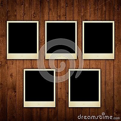 Polaroid photos on wooden texture