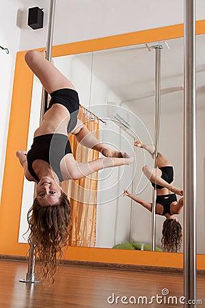 Pole dancer practicing