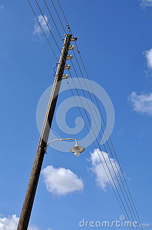 Pole with wires and lamp