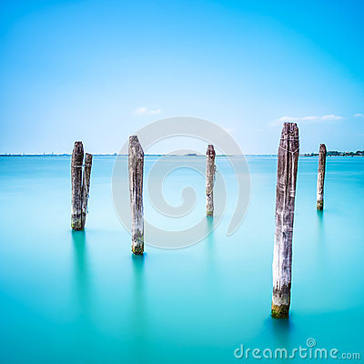 Free Poles And Soft Water On Venice Lagoon. Long Exposure. Royalty Free Stock Photo - 32753525