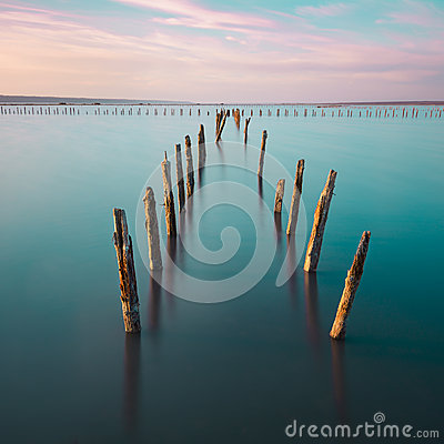 Free Poles In The Water -  On Sunset Clouds And Ocean Royalty Free Stock Image - 41991856