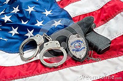 Police badge and gun