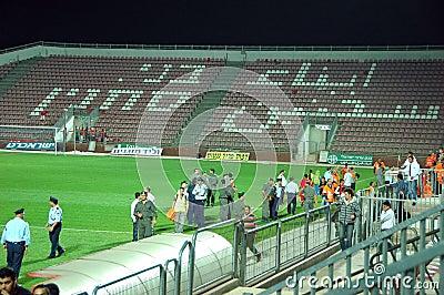 Police in Bnei Sakhnin empty stadium Editorial Image