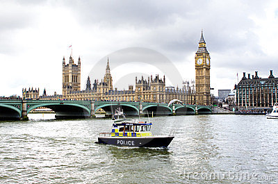 Police boat on the river thames outside parliment Editorial Stock Photo