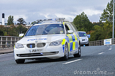 Police car with a blue light flashing Editorial Photography