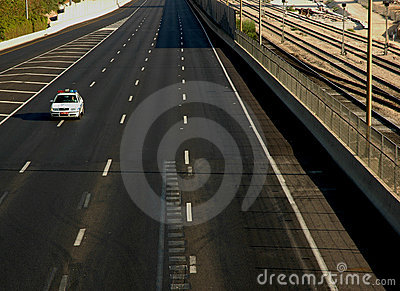 Police car on empty road