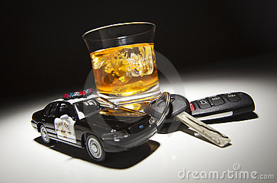 Police Car Next to Alcoholic Drink and Keys