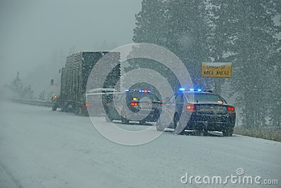 Police cars stop to assist