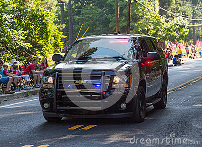 Police Cruiser Leading Parade Editorial Stock Image