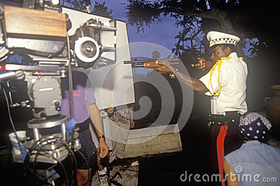 Police with gun scene from set of  Temptation Editorial Stock Photo